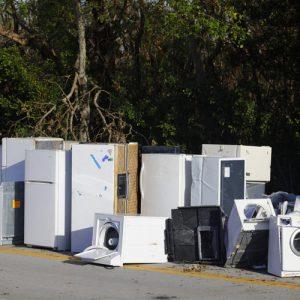 IMage of old appliances left outside for trash pickup